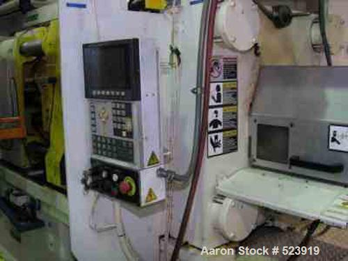 """USED: 300 ton, 32 oz, HPM injection molding machine, model T300-32. New 1997. 41,505 hours. Platen size 36.5"""" x 36.8"""". Dista..."""
