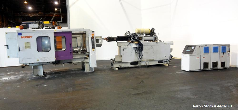 "Used- Husky Horizontal Injection Mold Machine, 300 Tons, Model SX300 RS60/50. Platen Size: 40.79"" x 40.79"". Distance Between..."