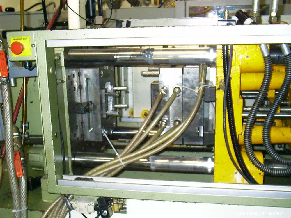 """Used-Nissin Injection Molding Machine, Model NC 100 FX26.  98 Ton clamp force, min mold 7.08"""", max daylight 24.8"""", tie bar c..."""