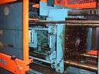 USED: Demag 60 ton injection molding machine, model D60-151. Distance between tie bars 12-1/2