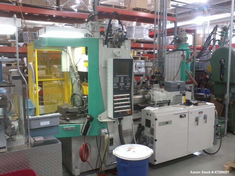 "Used- Engel Vertical Injection Molding Machine, Model 85 Rotary. 2 Station, 85 ton. Platen size 21.6"" x 12.60"". Daylight 9.8..."
