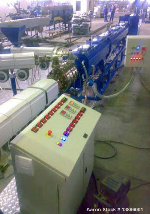 "Used-Pipe Extrusion Line. Pipe diameter 0.63"" - 1.58"" (16 - 40 mm), maximum capacity 88 lbs/hour (40 kg/h), 53.3 hp/40 kW, w..."