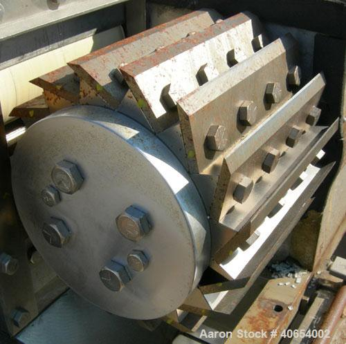 """Used- Cumberland 6 Pelletizer. 6 5/8"""" wide 16 bolt on blade rotor, (1) rubber, (1) metal manually adjustable pull roll.  Dri..."""