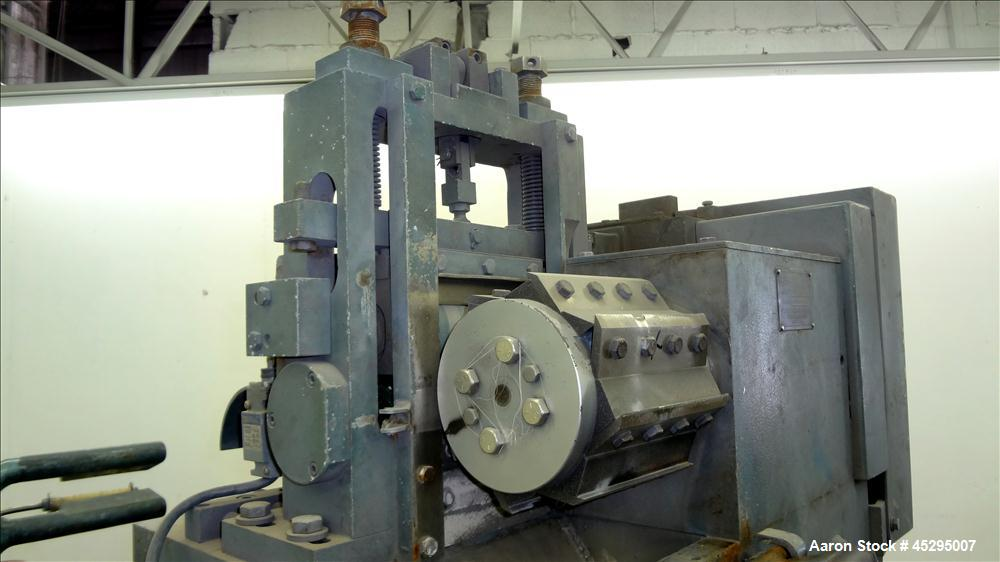 """Used- Cumberland Size 6 Pelletizer. Approximately 6-3/4"""" wide x 12"""" diameter (8) bolt on blade rotor; (1) rubber, (1) metal ..."""