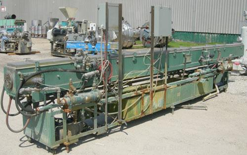 "Used- RDN Vacuum Sizing Tank, model 4D2V2T24, 304 stainless steel. 12"" wide x 12"" deep x 24' long. (4) sections with covers...."