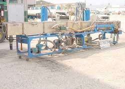 "USED:Vacuum sizing tank, stainless steel. 14"" wide x 14"" deep x 20'long. 4 sections. Unit includes (2) 1 hp MP pumps, (2) 5 ..."