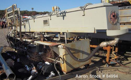 """Used- Conair Gatto Vacuum Tank, Model DPC0105C-14-3, stainless steel. Approximately 12"""" wide x 12"""" deep x 168"""" long. Unit co..."""