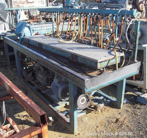 """Used- Profile Tool Calibration Table. Trough measures 44"""" wide x 28' long. Includes a water harness and vacuum pumps. Last u..."""