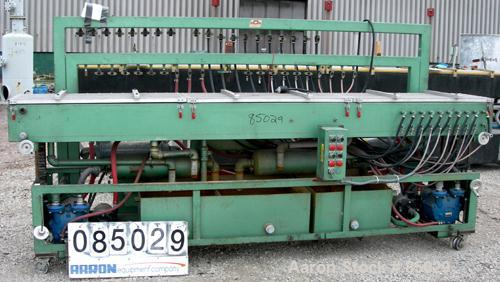 "USED: RDN vacuum sizing tank, 304 stainless steel. 20"" wide x 9"" deep x 12' long. Includes holding tank, heat exchanger, pum..."