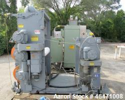 "Used- OMV Vertical 31.5"" Three Roll Sheet Stack."