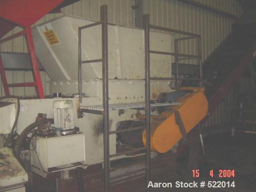 """USED: Holzmag single roll shredder. Material of construction is carbon steel on product contact areas. 11.7"""" diameter x 46.8..."""