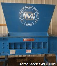 Used- Franklin Miller Taskmaster TM2842 Industrial Dual Rotor Shredder. 75 hp motor with stand and hopper. Overall dimension...