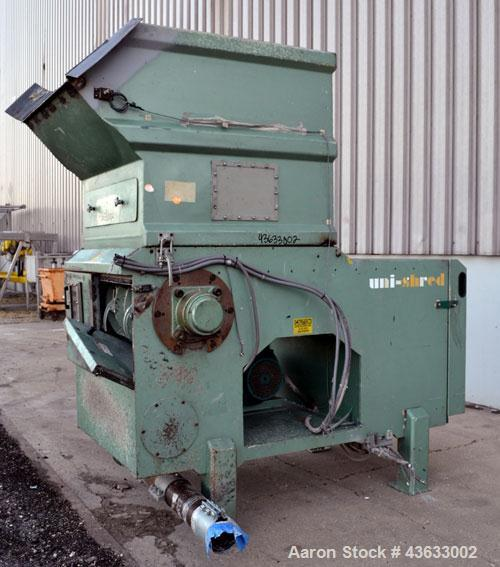 "Used- Uni-Shred Single Shaft Shredder, Carbon Steel. Approximately 14"" diameter x 44"" wide rotor with bolt-on cutters. Appro..."