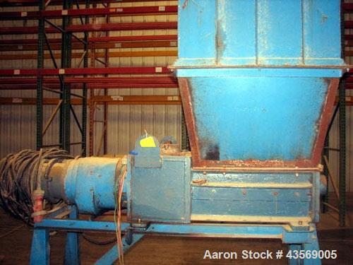 Used- Weil Twin Shaft Shredder, Carbon Steel. Independently driven shafts with 15 hp, 440 volt motors on each shaft. Approxi...