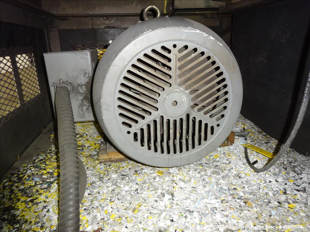 "Used- Grinder, Carbon Steel. Approximate 15"" x 26"" wide feed opening with tilt back pelican feed hopper. (3) bolt on tip bla..."