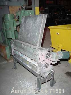 """USED- Gloucester Grinder, Model 50TP10. 3"""" wide x 40"""" long feed chute opening. (2) 4"""" diameter x 50"""" long rubber feed/pull r..."""