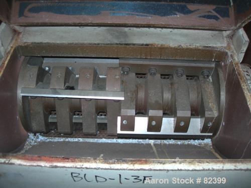 """USED: Hamilton/Tria grinder, model 60-35TD. Approximately 12"""" diameter x 24"""" wide 6 bolt-on staggered blades. Open rotor, (2..."""