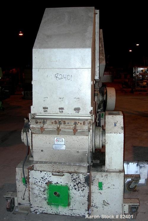 "USED: Hamilton/Tria grinder, model 60-35-TD. Approximately 12"" diameter x 24"" wide 6 bolt-on staggered blades, open rotor, (..."