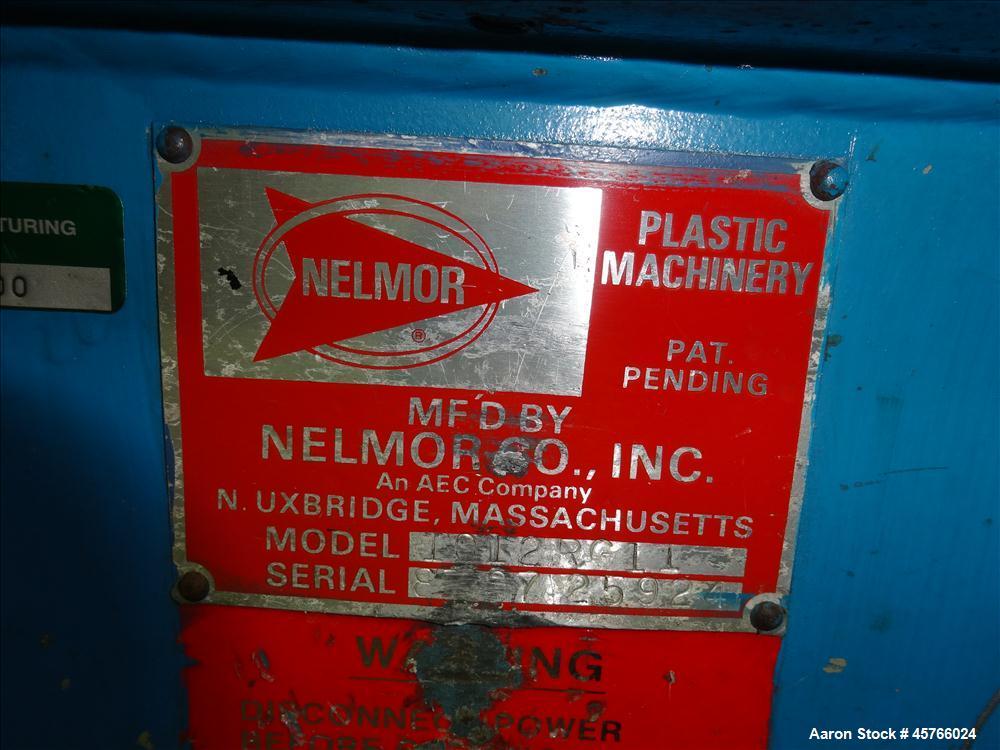 "Used- Nelmor Grinder, Model 1012RG11. Tilt back hopper. 13"" Wide chamber with open rotor, 3 bolt on blades and 1/4"" screen h..."