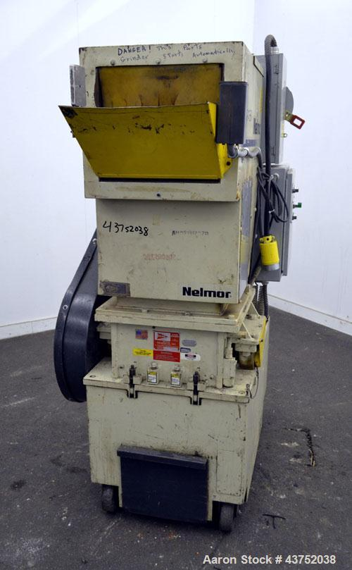 """Used- Nelmore Granulator, Model G1215P1. Approximately 12"""" diameter x 15"""" wide 3 bolt-on blade closed rotor. Tilt back pelic..."""