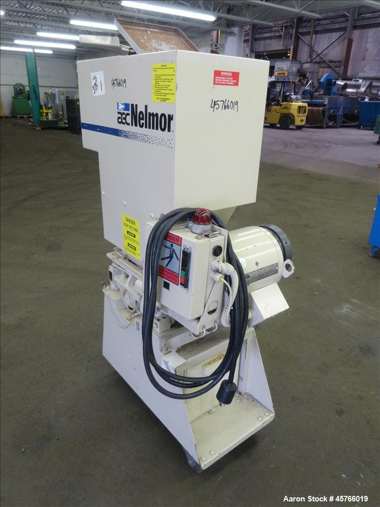"Used- AEC Nelmor Grinder, Model G810P1. Tilt back hopper, open rotor with 3 bolt on blades, 9-1/2"" long driven by a 7.5 hp, ..."