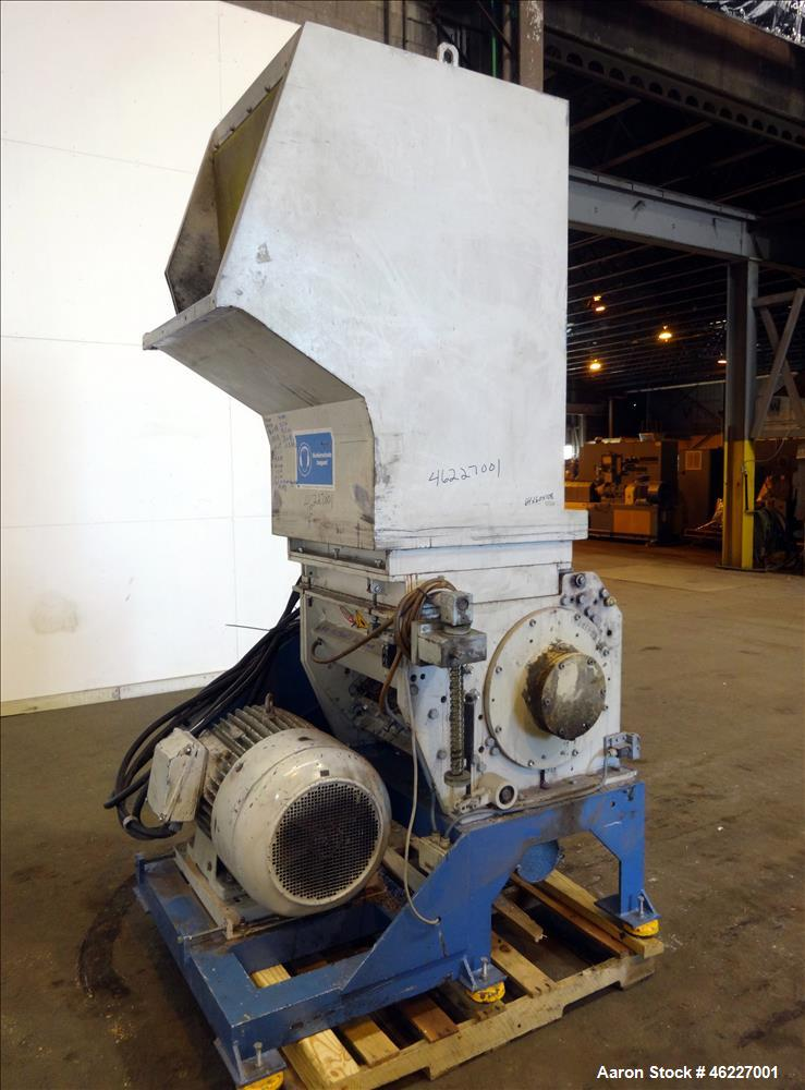 "Used- Tria Granulator, Carbon Steel. Approximate 20"" x 26"" feed throat with a bolt on feed hopper. Approximate (4) rows bolt..."