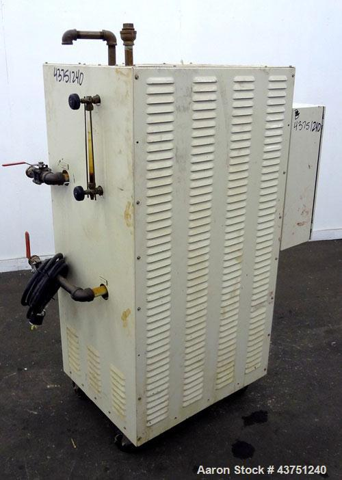 Used- Chromalox Hot Oil Temperature Control Heater, 9 kW, Model OTCSW-550-9XX. Includes a control panel. Mounted on casters....