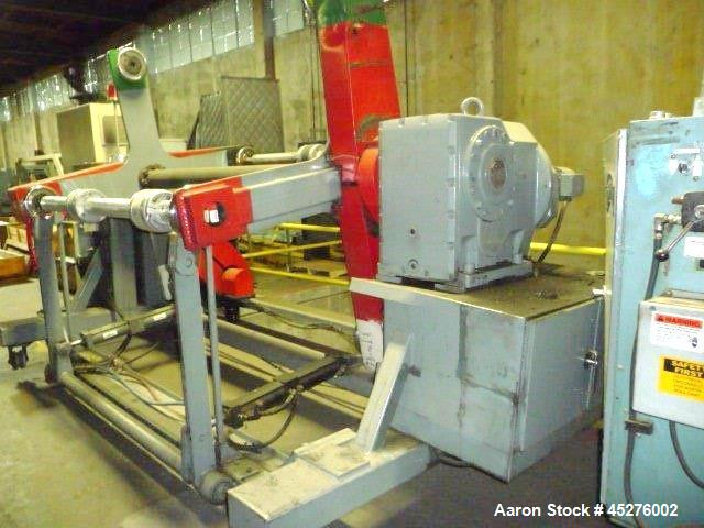 "Used- Crown 76"" Wide Turret Winder. Up to 60"" OD roll size, 2000# capacity, 4 position, single turret with motor drive."