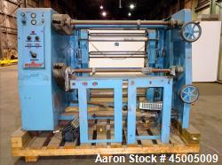 "Used- Johnson Dual Turret Winder, 48"" Wide. Approximate 18"" diameter roll capacity."