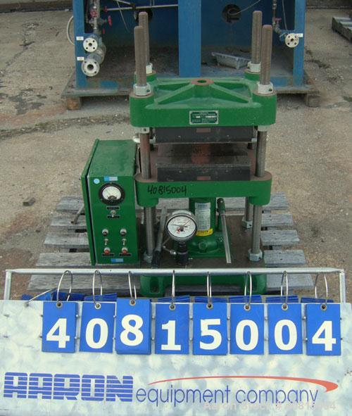 "Used-  Carver Manual Hydraulic Press, 12 Ton, Model 2696.  Hand operated for 0-12 tons (24,000 pounds).  (2) 12"" x 12"" elect..."