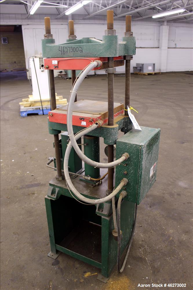 "Used- Carver Laboratory Manual Press, Model 2699, 30 Ton Clamping Force. Hydraulic, 4 post upstroke type. (2) 12"" long x 12""..."
