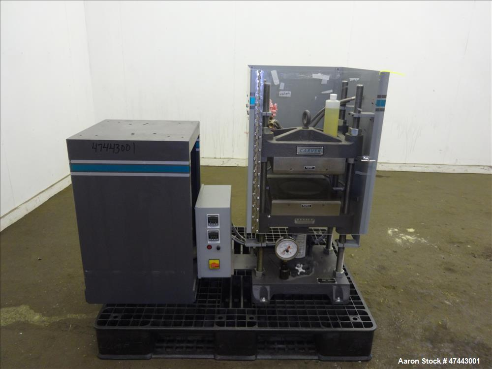 Used- Carver Heated Four Post Manual Hydraulic Press, Model 12-12H (4122), 12 To