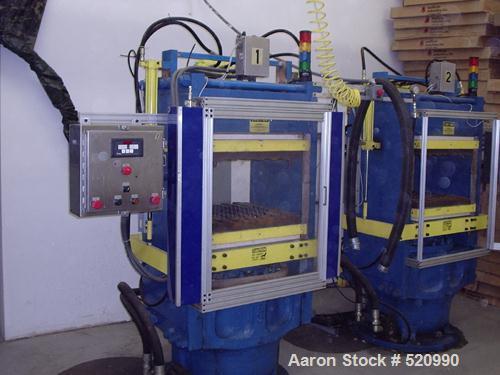 USED: French Oil slab side compression molding machine. With PLC controls, 4 station hydraulic manifolds. Three zone electri...