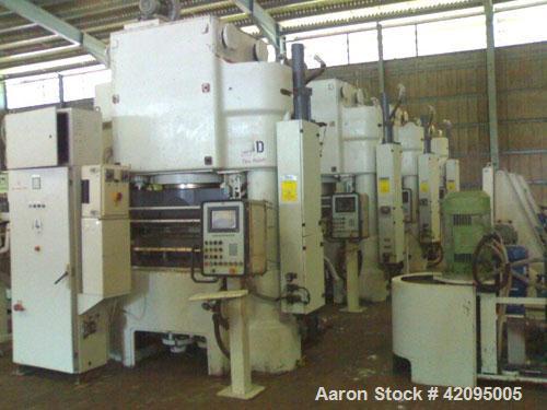 Used-Laeis Bucher Alpha 800 Press. 881.9 tons (800 metric tons) press force, 33 tons (30 metric tons) ejection force, fillin...