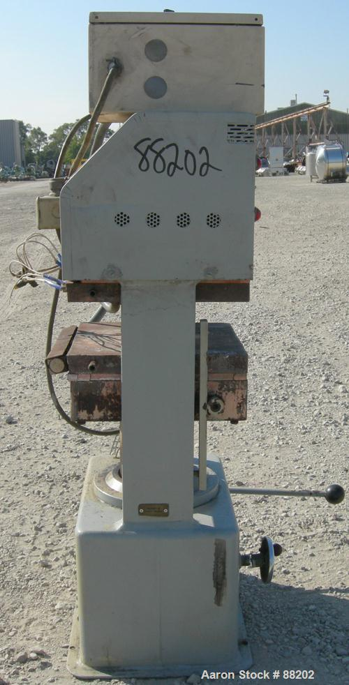"USED: PHI manual compression press, approximate 50 ton. Up acting cylinder. 12-1/2"" x 12-1/2"" electrically heated platens. A..."
