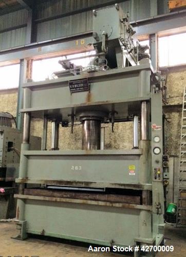 "Used- 600 Ton KR Wilson Hydraulic Press. 4 post downstroke type. Floor standing. Distance between 7"" diameter posts 120"" L-R..."