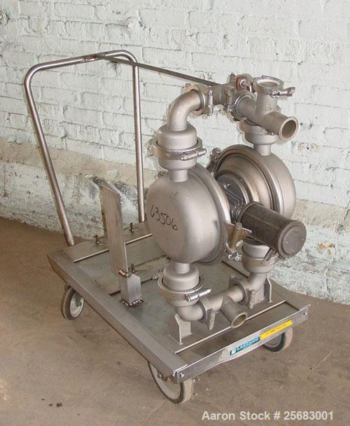 "Used- Diaphragm Pump, Air Operataed, stainless steel. 2"" tri-clamp inlet/outlet. Mounted on a stainless steel cart with cast..."