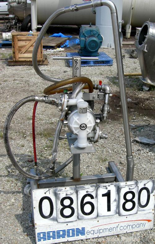 """USED: Wilden air operated double diaphragm pump, model M2CHAMP, plastic. Rated 27 gallons per minute, 125 psi. 1-1/2"""" flange..."""