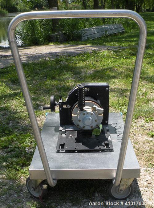 "Used- Masterflex Peristolic Pump, Model 7584-80.Rated 25 scfm maximum air, 100 psi max, speed 35-350 rpm.(2) 7/8"", and (2)..."
