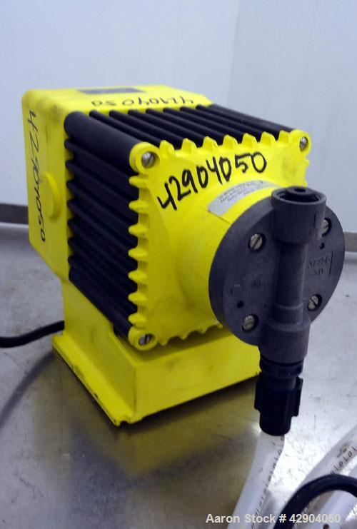 Unused- LMI Milton Roy Chemical Metering Pump, Model B141-318TI. PVC molded head. Rated 0.007 gallons per minute (7 gallons ...