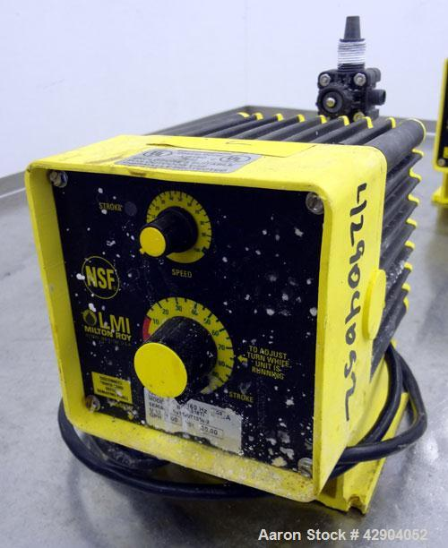 Used- LMI Milton Roy Chemical Metering Pump, Model B141-318TI. PVC molded head. Rated 0.007 gallons per minute (7 gallons pe...