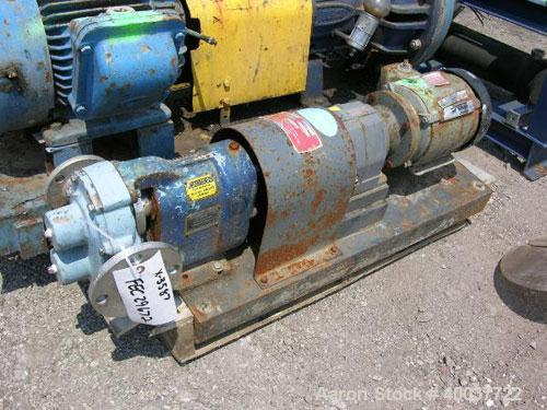 "Used-Waukesha Rotary Lobe Pump, Model 25, stainless steel construction, 1.5"" inlet/outlet, rated up to 30 GPM, on base with ..."