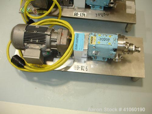 "Used- Waukesha Rotary Lobe Pump, Model 006. Stainless steel construction, 1.5"" inlet/outlet, rated approximately 5 gpm on ba..."