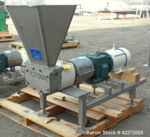 Used- APV Rectangular Inlet Top Feed Rotary Positive Displacement Pump, model R6RH, 316 stainless steel. Approximate capacit...