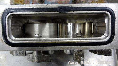Used- Stainless Steel Waukesha Rectangular Flange Universal Rotary Positive Displacement Pump, Model 034