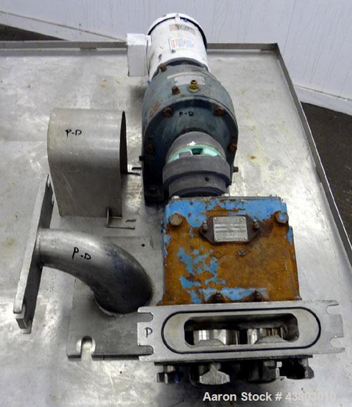Used- Waukesha Rectangular Flange Universal Rotary Positive Displacement Pump, Model 034, 316 Stainless Steel. Approximately...
