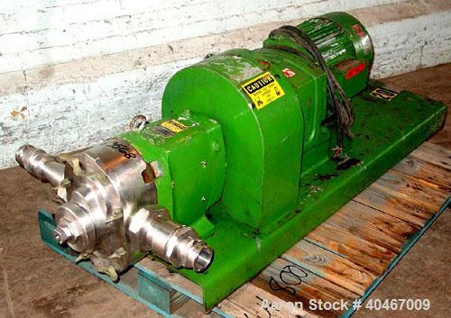 Used- Waukesha model 130 positive displacement pump. Stainless pump head, 3 in sanitary threaded inlet / outlet, 10 hp, 3/60...