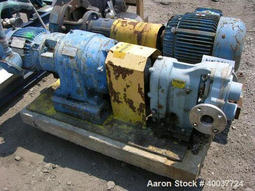 """Used- Waukesha Rotary Lobe Pump, Model 55I, stainless steel construction, 2"""" inlet/outlet, rated up to 60 GPM, on base with ..."""
