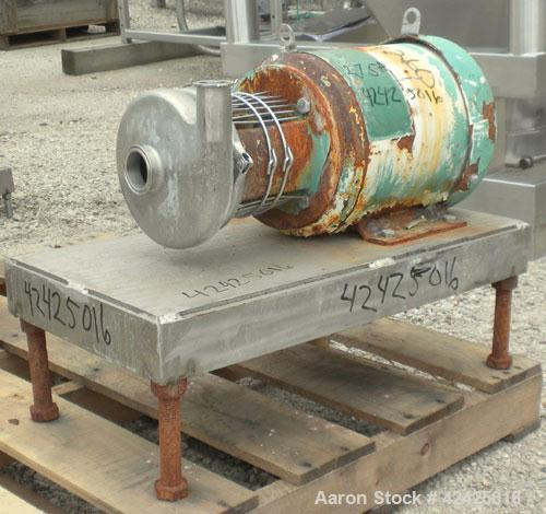 "Used- Tri-Clover Centrifugal Pump, 316 Stainless Steel. 2"" Sanitary inlet, 1-1/2"" sanitary outlet. Approximately 5-1/4"" diam..."