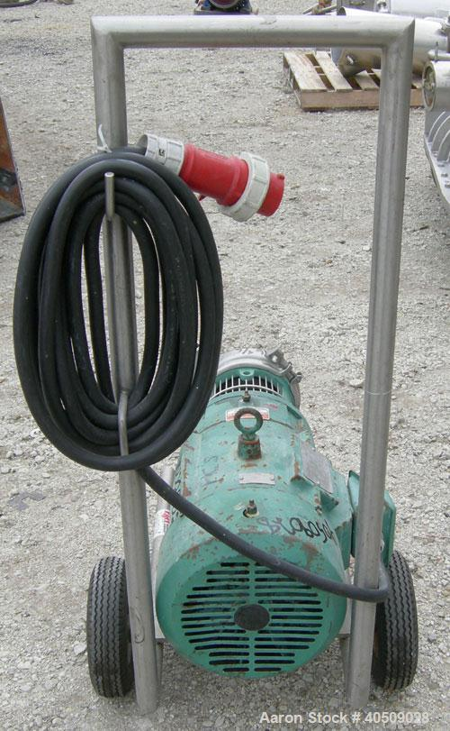 "Used- Tri Clover Centrifugal Pump, model C216MD21T-S, 316 stainless steel. 2"" tri-clamp inlet, 1 1/2"" tri-clamp outlet. Appr..."